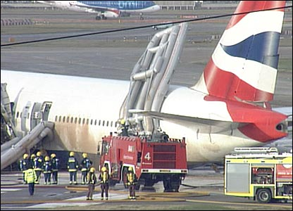 Fire crews by stricken plane