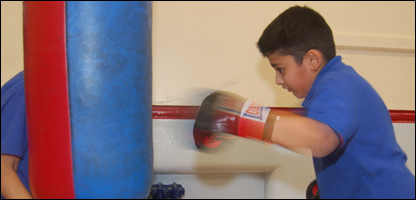 Boys boxing at school