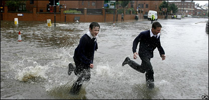 School kids running through the flood waters in Leeds