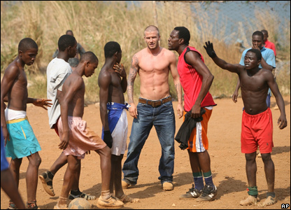 David Beckham joins in a football game in Sierra Leone.