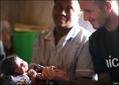 David Beckham holds the hand of two-day-old Mariatsu