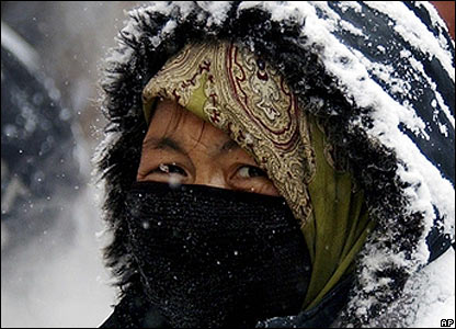 Woman covering her face against the cold