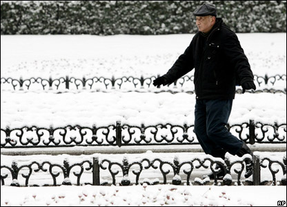 A man in a snowy park