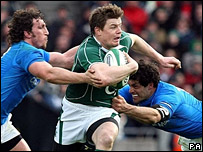 Ireland's Brian O'Driscoll being tackled by Italian players