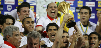 Captain Ahmed Hassan holds up the cup