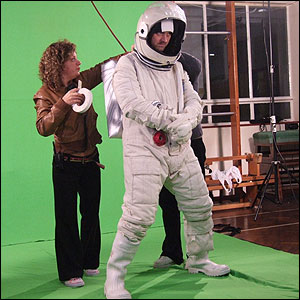We dressed the actor up in the spaceman outfit and filmed his scenes in front of a big green screen.