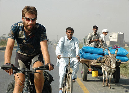 Mark gets some company in Pakistan. He's travelled 18,000 miles in 195 days. He's raising cash for charity with the challenge.