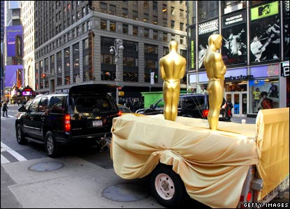 Two statues are transported for a famous after show party