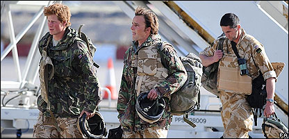 Harry, left, arrives home