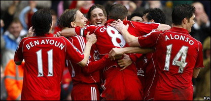 Liverpool players celebrating their win