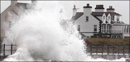 Storm waves break over the sea wall at Trearddur Bay in North Wales.