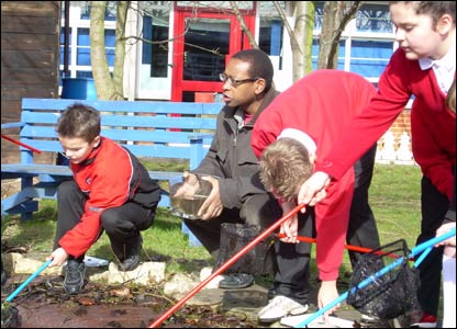 Lizo and pupils at a Peterborough junior school see what's in the pond