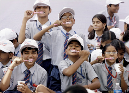 Indian school children brush their teeth