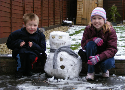 Elizabeth and Andrew with their snowman