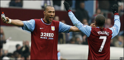 Aston Villa's John Carew, left, and Ashley Young, celebrate after beating Birmingham City 5-1,