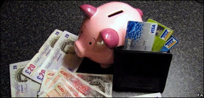 Piggy bank, credit cards and cash