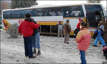 People getting onto bus