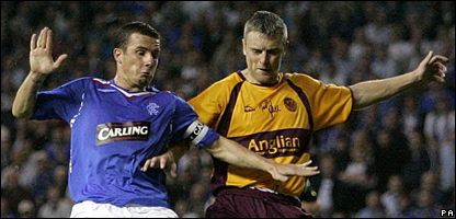 Motherwell's Stephen Craigan and Rangers' Barry Ferguson battle for the ball