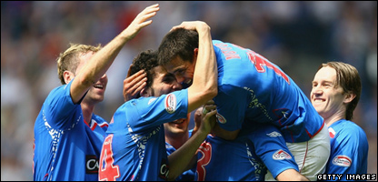 Nacho Novo of Rangers is congratulated