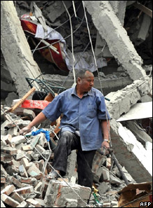 Someone searching the rubble for survivors