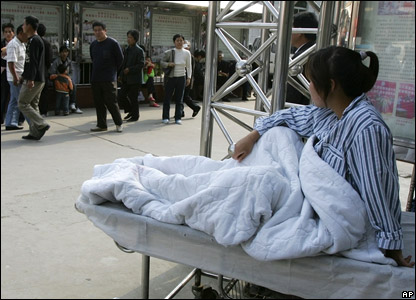 Patients were moved out of a hospital in Fuyang after the quake struck.