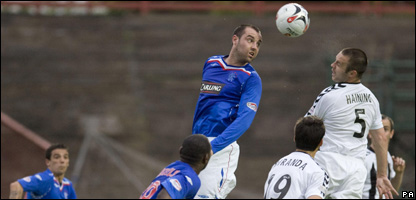Rangers' Kris Boyd gets to the ball in the St Mirren penalty area