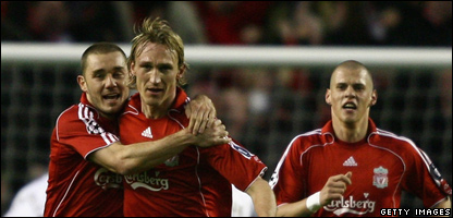 Sami Hyypia of Liverpool celebrates scoring an equalising goal with team mate Fabio Aurelio