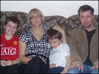 Arron, 10, and Ben, eight, with their mum and dad