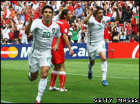 Deco of Portugal celebrates after scoring the opening goal