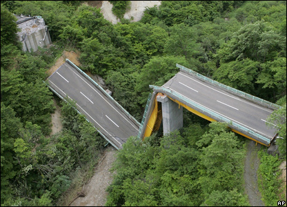 A large part of a 95-meter bridge is collapsed  (AP Photo/Kyodo News)