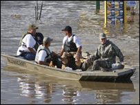 Men delivering sandbags by boat in Iowa, America