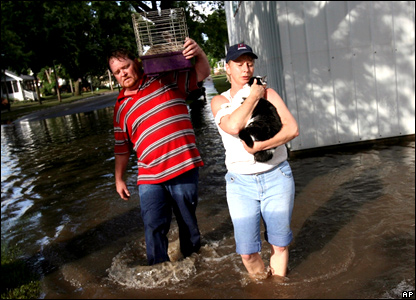 A couple rescuing their pets from floods in Iowa