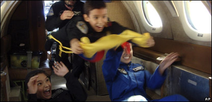Jules, 7, (center) floats with his brother Gerard (bottom left) during the zero gravity flight