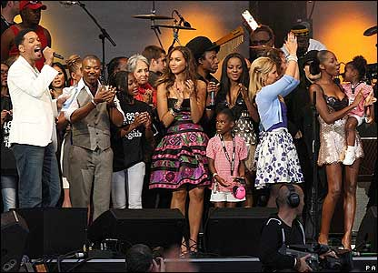 Celebs crammed onto the stage to welcome the former president of South Africa.