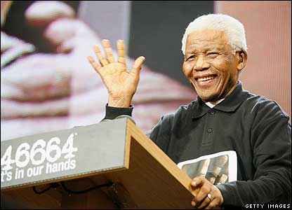 "Nelson Mandela made a speech on stage. Mr Mandela told the crowd: ""Even as we celebrate, let us remind ourselves that our work is far from complete - our work is for freedom for all."""