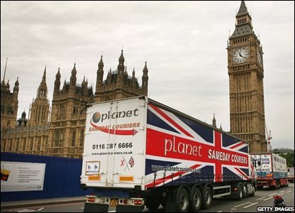 Truckers driving in convoy past the Houses of Parliament in London