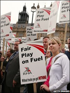 Truckers stage a protest against fuel prices outside the Houses of Parliament