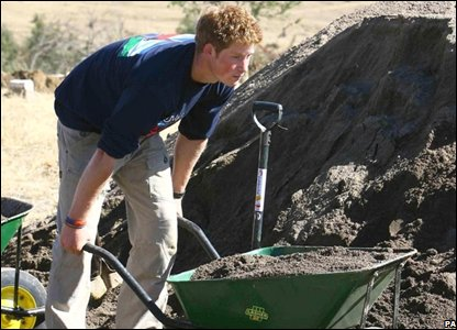 Prince Harry pushing a wheelbarrow