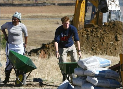 Prince Harry helps out with the rebuilding of a school for disabled children in Lesotho