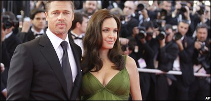 Brad Pitt and a pregnant Angelina Jolie before the birth