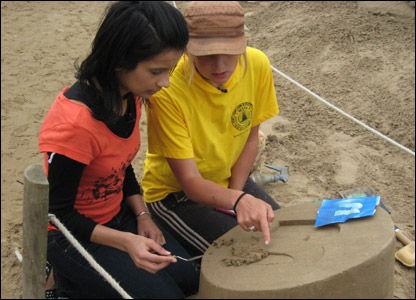 Sonali making a sand sculpture
