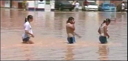 Children walking across floods