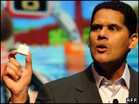 "Reggie Fils-Aime, president of Nintendo America displays the new ""Wii MotionPlus"" accessory"