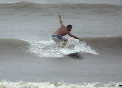 Greg Trevino surfing in Texas