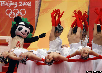 Dancers celebrate as the Olympic torch reaches Beijing