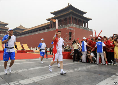 Chinese astronaut Yang Liwei runs the start of the Olympic torch relay at Forbidden City, Beijing