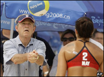 George Bush playing beach volleyball with American athlete Misty MayTreanor