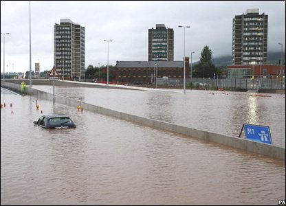 A car in the severe floods on the Westlink area of Belfast, Northern Ireland