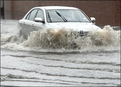 A motorist is caught in the severe floods on the Westlink area of Belfast, Northern Ireland