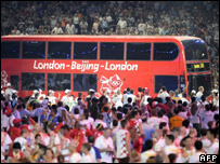 The London bus being driven through Beijing's Bird's Nest stadium